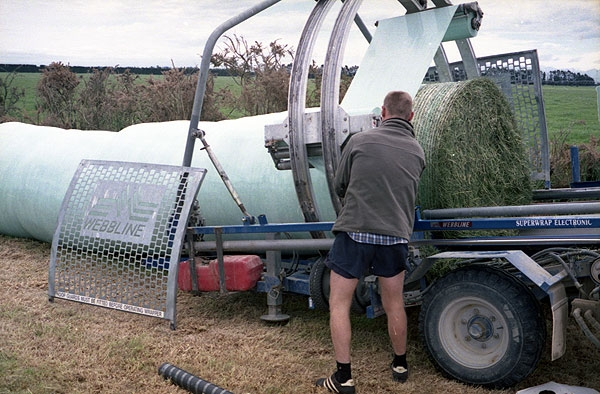 Silage wrapping machine at Dunsandel. Minolta 7s Rangefinder Camera.