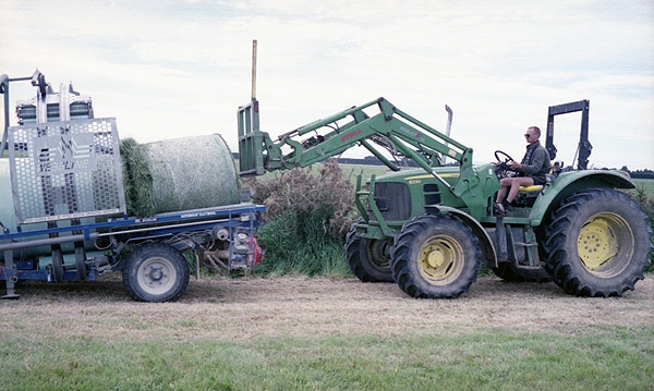 Loading silage into the wrapping machine at Dunsandel. Minolta 7s Rangefinder Camera