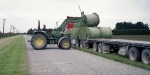 Unloading silage bails for wrapping on a dairy farm near Dunsandel. Minolta 7s Rangefinder Camera.