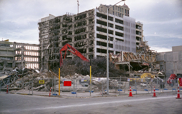 View from the intersection of Colombo and Gloucester Streets, Christchurch, of buildings during demolition following the devastating Canterbury earth quakes of 2010 and 2011. Photograph taken November 2012. Yashica Electro 35