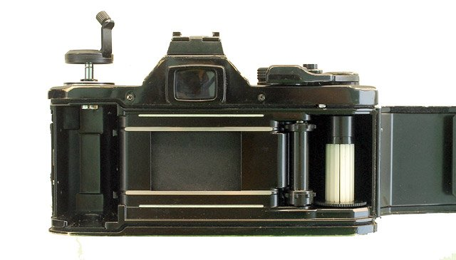 Pentax MX 25mm SLR film camera with open back.