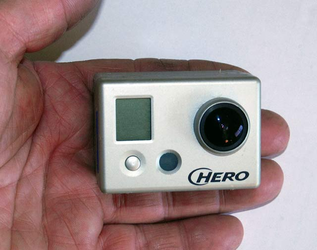 "When used ""naked"" without the protective plastic case the GoPro is much smaller to use hand-held. However you have to be careful not to touch the front of the lens."