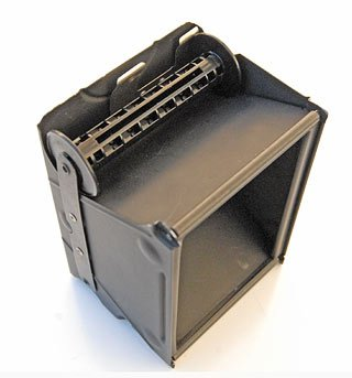 Kodak Box Brownie Flash II film holder with a 120 spool in place. The wider spool ends hit the top of the camera when the film holder is inserted.